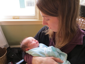 Jaime Healy-Plotkin Postpartum Doula with a newborn